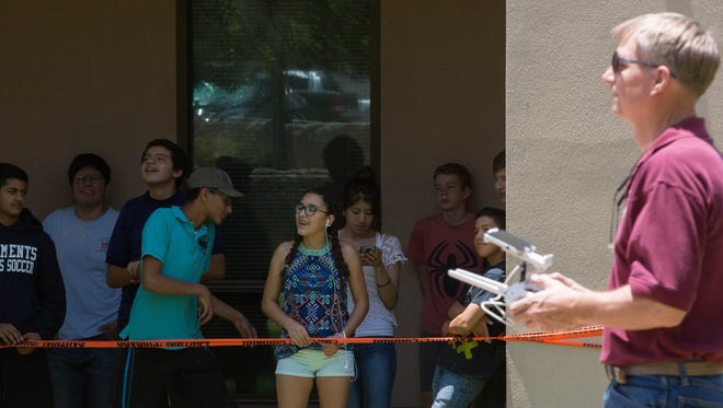 High school students in the ACT Summer Program at Doña Ana Community College watch as Tim Lower flies a small drone during a demonstration about how they work and what New Mexico State University is using them for, Wednesday June 13, 2018. During the ACT Summer Program not only are students studying for the ACT's but they are also being visited by professionals and students from the university in a variety of science, technology, engineering and math fields as a way of showing them what is being offered locally and sparking their interest in higher education.