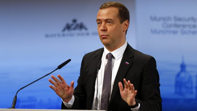 Russian Prime Minister Dmitry Medvedev gestures during his speech on the podium at the Security Conference in Munich, on Feb. 13.