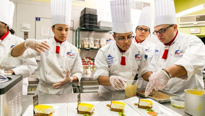 Members of the competition team at The Culinary Institute of New York at Monroe College in New Rochelle prepare a dessert dish to prepare for the American Culinary Federation's National Competition this weekend in Phoenix.
