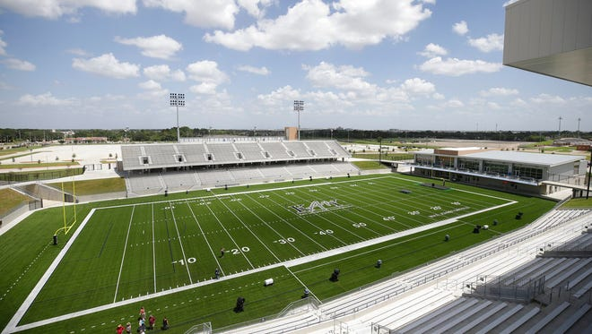 This Thursday, Aug. 17, 2017, photo shows the Mike Johnston Field at Katy ISD Legacy Stadium in Katy, Texas. The Houston-area school district will hold its first game next week in its new $72 million football stadium, believed to be the most expensive high school stadium ever built.  (Melissa Phillip/Houston Chronicle via AP)