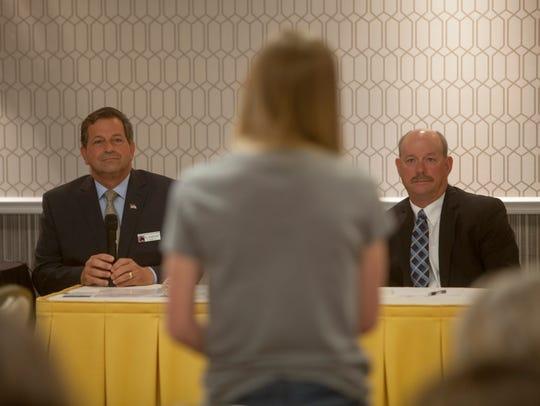 Gil Almquist (left) and Allen Davis debate in a forum