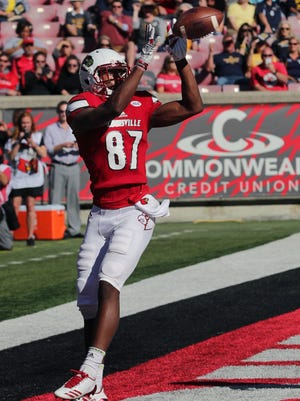 Louisville's Des Fitzpatrick catches a touchdown against Murray State.