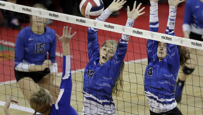 Merrill's Kaylee Bowe, left, and Maddix Bonnell try to block a shot from Catholic Memorial's Tatum Brim in a Division 2 semifinal during the WIAA state girls volleyball tournament last November. The Bluejays face Luxemburg-Casco in a state semifinal Friday.