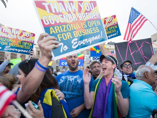 Protesters celebrate in February after Gov. Jan Brewer said she would veto Senate Bill 1062.