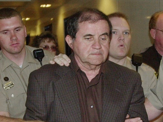 Jefferson County sheriff's deputies lead Thomas E. Blanton Jr. out of the courtroom after a jury convicted him of murder in Birmingham on May 1, 2001.