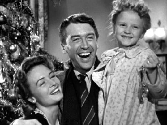 "Donna Reed, left, James Stewart and young Karolyn Grimes in the 1946 original, ""It's a Wonderful Life."""