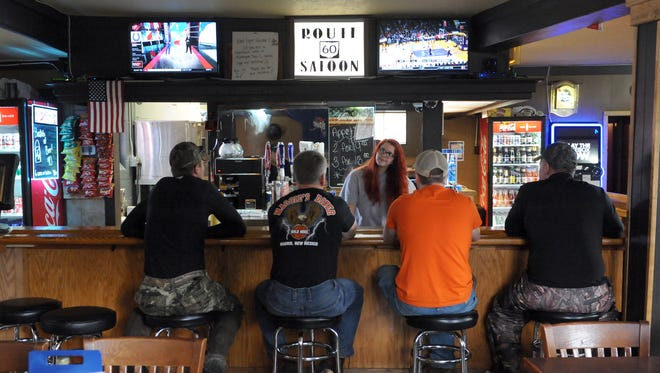 Customers stop in for a drink at the Route 60 Saloon on Frazeysburg Road in Dresden. The newly renovated bar, which offers primarily burgers, sandwiches and fried food on its food menu, had a soft opening Sept. 22.