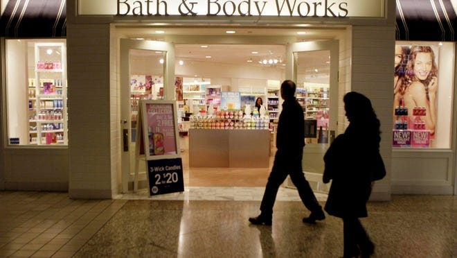 In this Feb. 22, 2010 file photo, people walk by a Bath and Body Works at a shopping mall in Dallas.