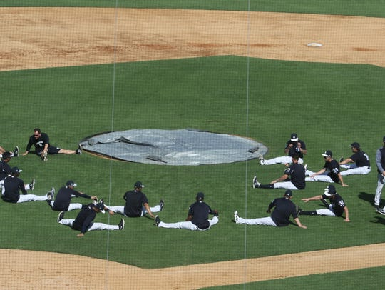 Members of one of several practice squads stretches