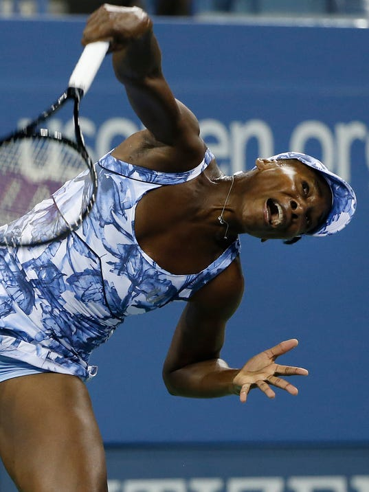Venus Williams, of the United States, serves to Timea Bacsinszky, of Switzerland, during the second round of the U.S. Open tennis tournament Wednesday, Aug. 27, 2014, in New York. (AP Photo/Jason DeCrow)