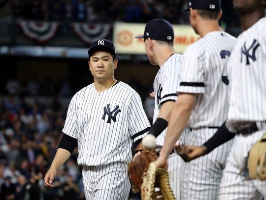 Masahiro Tanaka of the New York Yankees reacts after