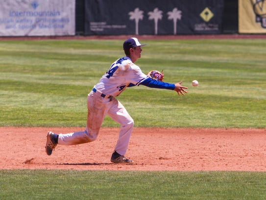 Dixie's Kayler Yates makes a throw to second base during