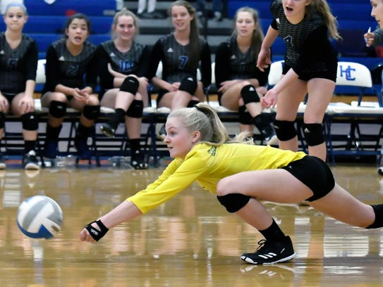 Harper Creek's Kylee Crandall (0) dives for the ball