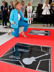 Nashville philanthropist Martha Ingram receives her star on the Music City Walk of Fame during an induction ceremony Thursday, April 27, 2017, at Walk of Fame Park in Nashville.