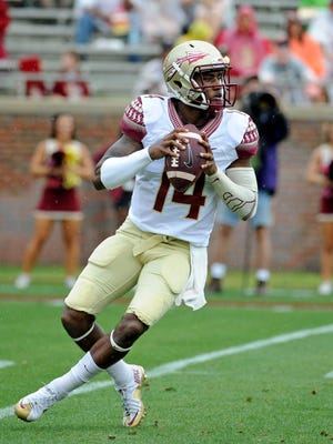 Apr 11, 2015; Tallahassee, FL, USA; Florida State Seminoles quarterback De'Andre Johnson (14) looks to throw the ball during the spring game at Doak Campbell Stadium. Mandatory Credit: Melina Vastola-USA TODAY Sports