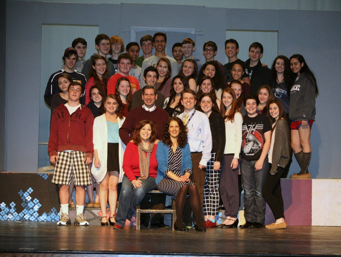 """The cast and crew of """"The Drowsy Chaperone"""" pose for a photo as they rehearse for this years production at Pelham Memorial High School,  March 20, 2014."""