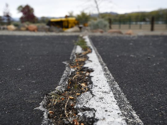 A large crack in the parking lot is seen at Bartley Ranch Regional Park in Reno on April 7, 2015.