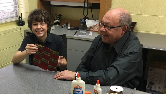 David, a seventh-grade Farmington Hills resident, shares a weaving project with his grandfather.