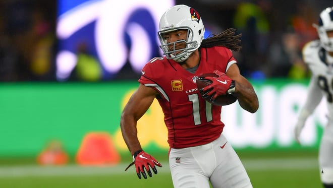Arizona Cardinals wide receiver Larry Fitzgerald (11) makes a run in the first quarter during the NFL International Series game against the Arizona Cardinals at Twickenham Stadium.