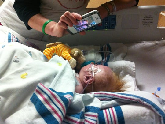 Joseph Ryan was born Dec. 14, 2012, with half of his heart undeveloped. Here he FaceTimes with his older siblings.