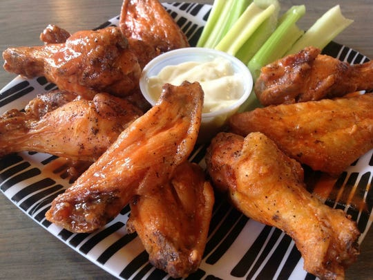 Slice in Washington Township offers wings for Super Bowl parties. It also has delicious wings made from fresh chicken that's seasoned before being baked and then fried. Special diets are no problem at Slice, as they also have gluten-free pizza or gluten-free, breading-free wings cooked in a fryer dedicated to gluten-free foods. Vegan options are also available.