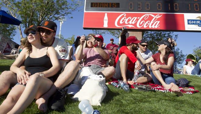 San Francisco Giants fans watch Cactus League play at Scottsdale Stadium.