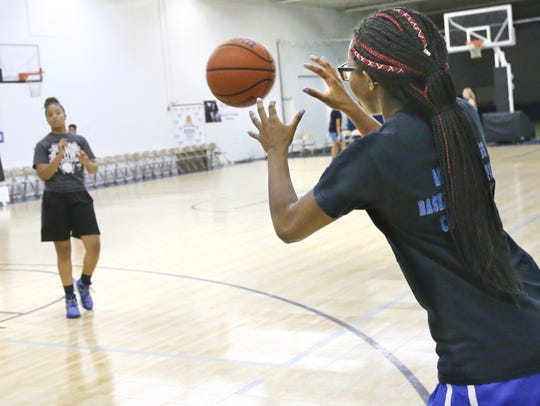 India Jordan, from School of the Arts, right, takes the pass from Harley-Allendale Columbia's Jalen Nowden, as she works on her long-range jumpers at an AAU girls basketball practice at Reaves Sports Gym Monday, July 23, 2018 in Rochester.