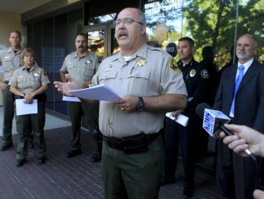 Shasta County Sheriff Tom Bosenko holds a news conference