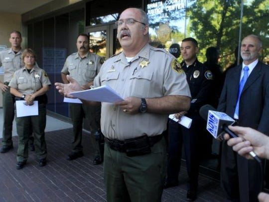 Shasta County Sheriff Tom Bosenko holds a news conference Monday morning, July 23, 2012 outside the Shasta County jail. He announced that he has reopened half of the third floor of the jail, closed since 2009.