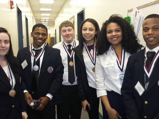 St. Georges students Rachel Hirst, Isaih Brown, Jared Margerison, Madison Ferguson, Amanda Merritt, and Elijah Monk showing off HOSA medals.