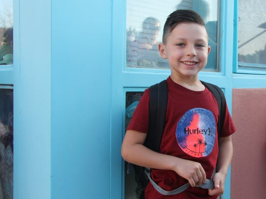 Kindergartner Stetson Olivas attends his first day of school Wednesday, Aug. 9, 2017. Stetson's parents, Bryan and Katie Olivas, said they were nervous but excited for their youngest child's first day.