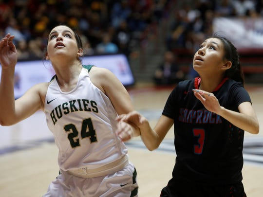 Hope Christian's Destiny Holien, left, and Shiprock's Kylie McKinley fight for rebound position on Friday at The Pit in Albuquerque.
