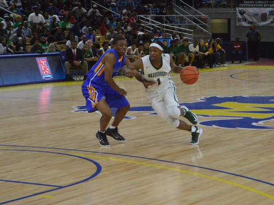 Peabody senior Cedric Russell (1) drives to the lane