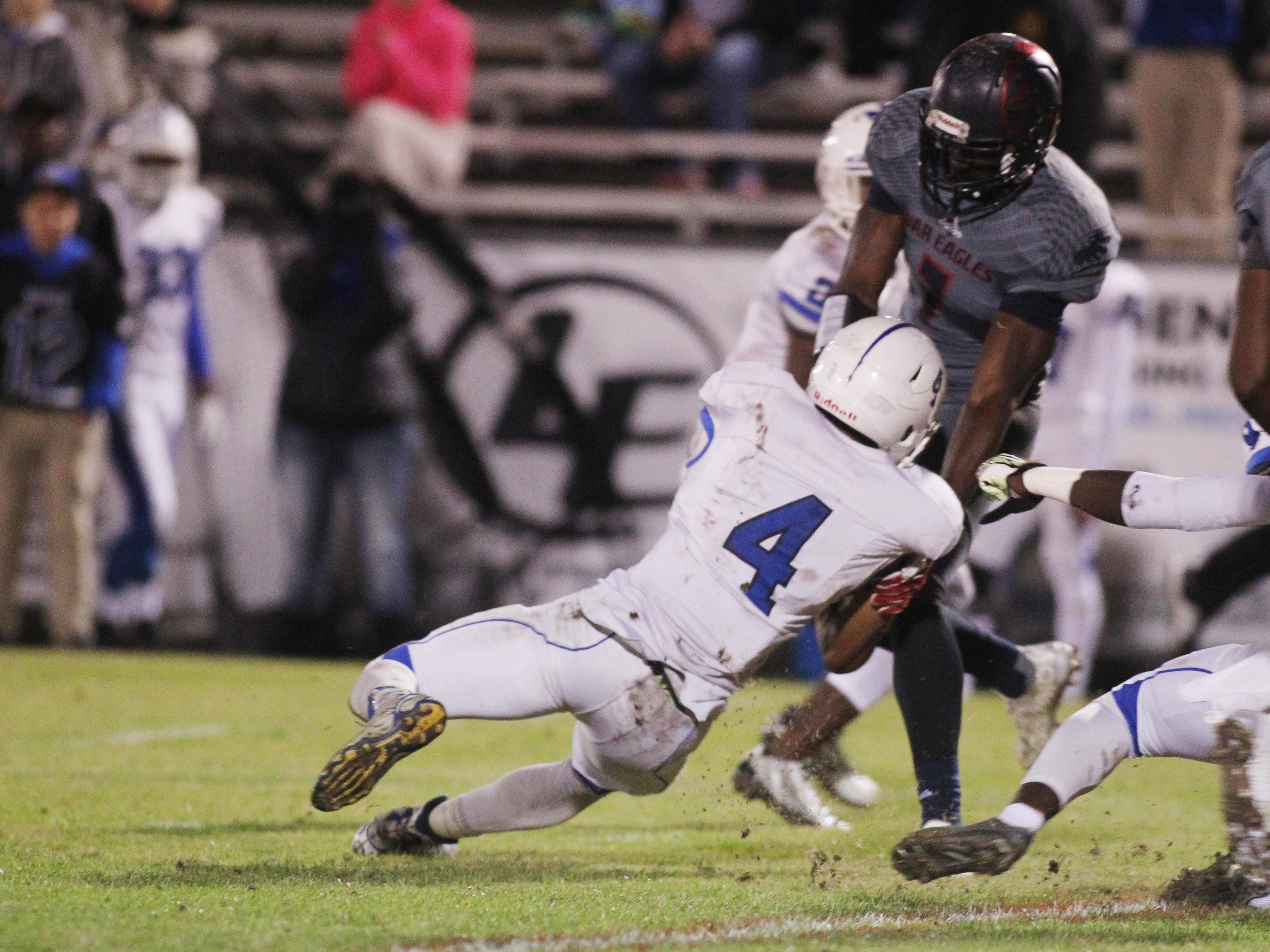 Wakulla safety Keith Gavin goes for a strip against Clay running back Bilal Ally, who was limited by the War Eagles' defense to 152 yards on 35 carries.