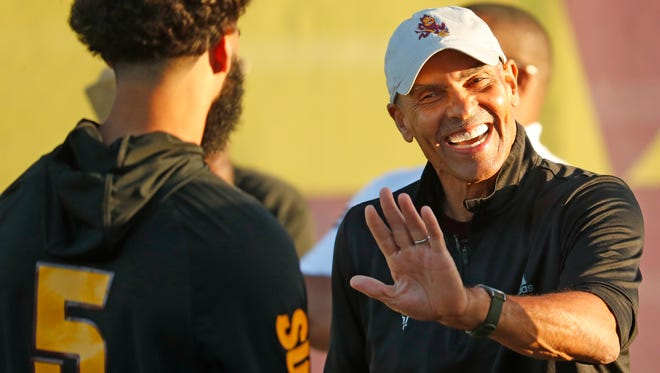 ASU head coach Herm Edwards jokes with quarterback Manny Wilkins (5) before the Spring Game at Sun Devil Soccer Stadium in Tempe, Ariz. on April 13, 2018.