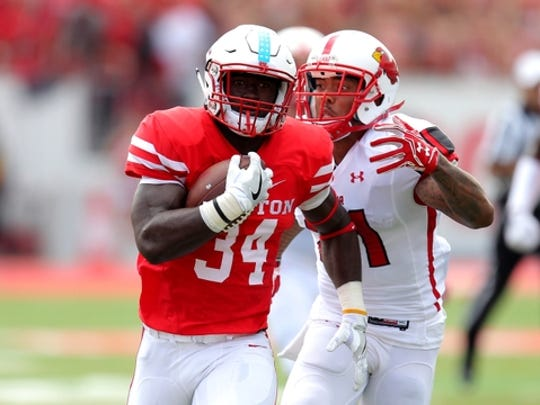 Sep 10, 2016; Houston, TX, USA; Houston Cougars running back Mulbah Car (34) carries the ball while being pursued by Lamar Cardinals defensive back Brendan Langley (21) during the first quarter at TDECU Stadium. Mandatory Credit: Erik Williams-USA TODAY Sports