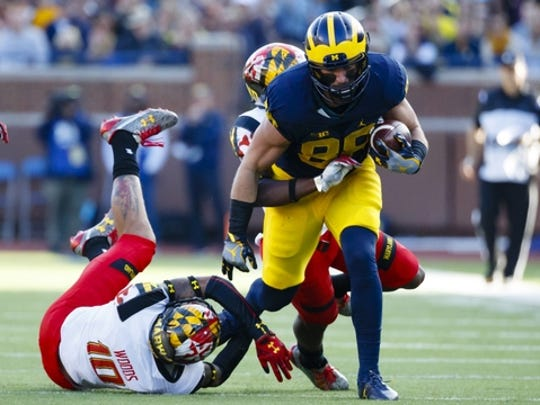 Michigan Wolverines tight end Jake Butt (88) rushes in the first half against the Maryland Terrapins at Michigan Stadium.