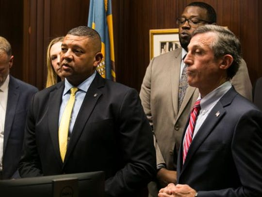 Gov. John Carney (right) and Delaware Department of Correction Commissioner Perry Phelps (left) stand together at a press conference announcing new prison reentry initiatives.