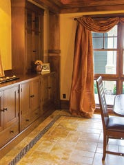 All the walls in the home are painted—no wallpaper—and many have faux touches, such as in the dining room painted by decorative painter Michelle Fallone.