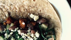 Sweet potato, beans, kale and Cotija cheese make up this flavorful — and health — wrap.