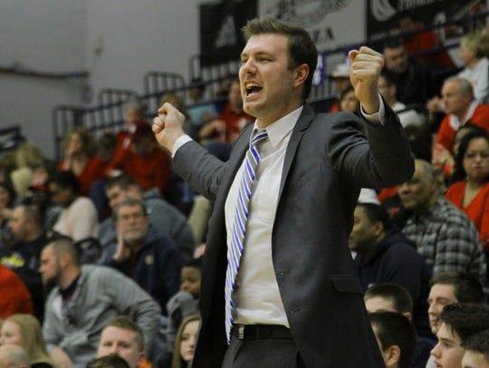 Providence head coach Andrew Grantz guides his team