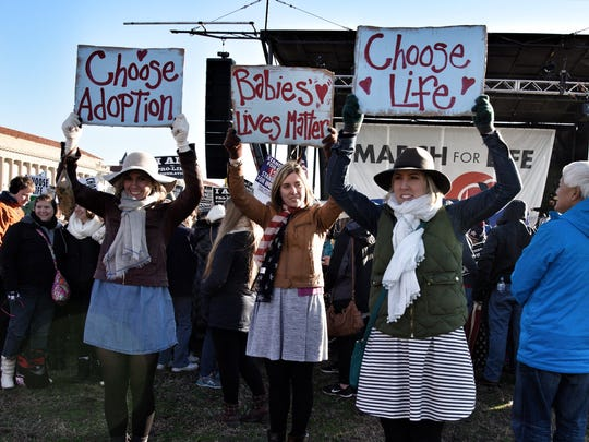 Sisters MacKenzie, Madeline and Meredith Fortener, ages 23, 22 and 26 respectively, left to right, of Wyandotte, Mich., rally to end abortion at the March for Life Friday, Jan. 27, 2017 in Washington, D.C.