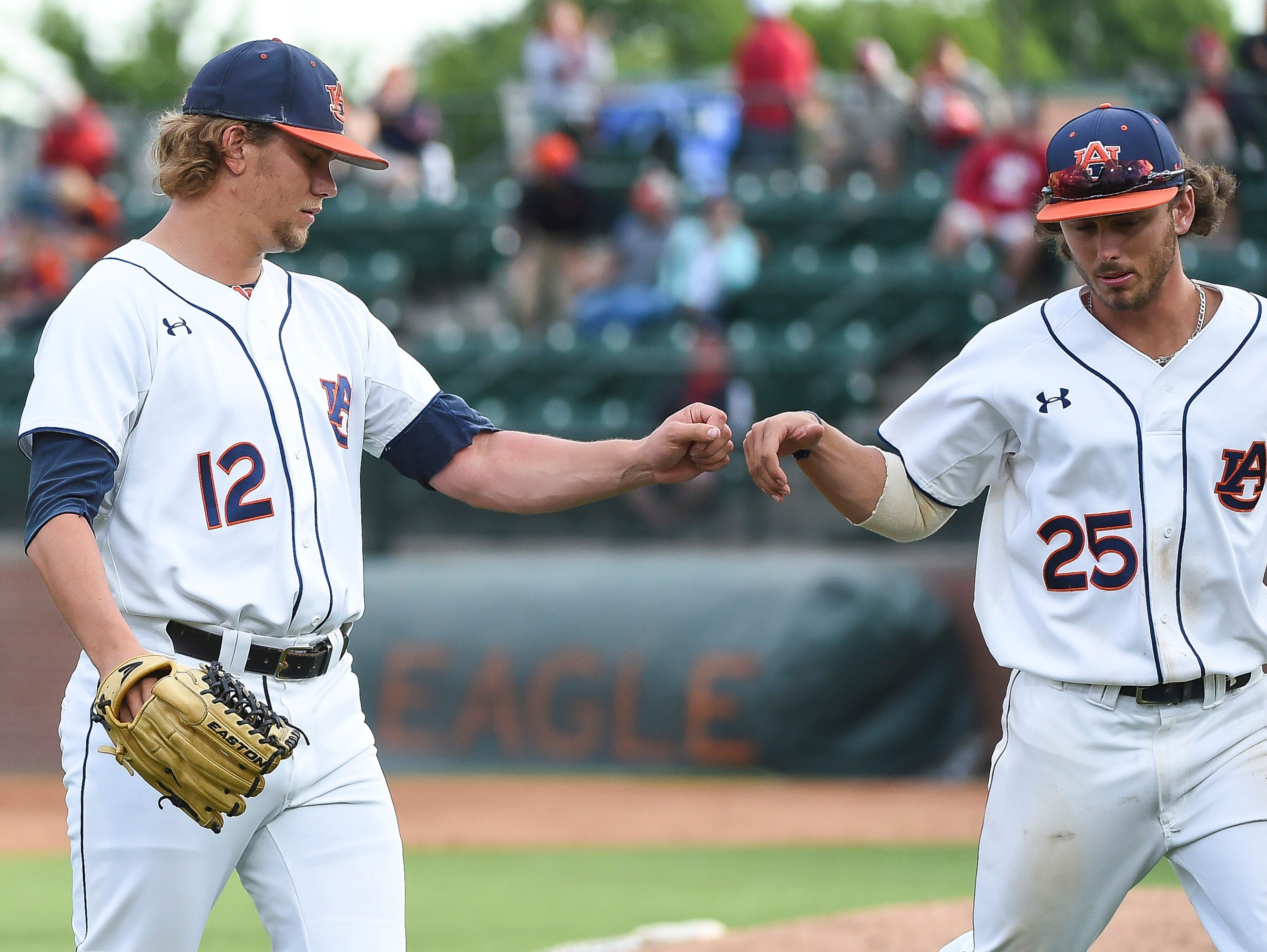 Auburn pitcher Andrew Mitchell gets the win in a 11-6 victory over No. 14 Arkansas after working the final five innings Sunday.