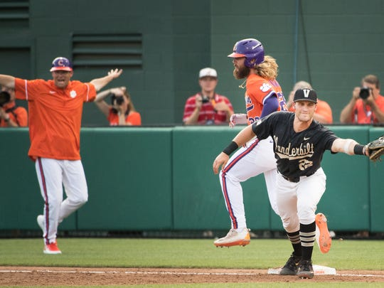 Clemson left fielder Reed Rohlman (26) is called safe