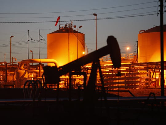 David McNew,  Getty Images An increase in oil and gas