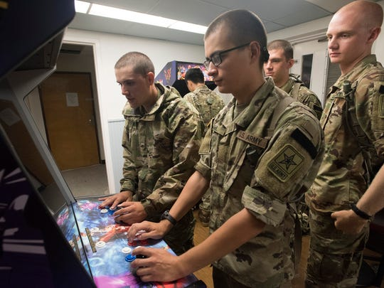 Military personnel enjoy the new USO lounge at Corry Station on Wednesday, Aug. 30, 2017. The new 1,400-square-foot facility features arcade games, WiFi, flat-screen TVs, a study bar, rest area, self-serve kitchen and an outdoor recreational space for special events.