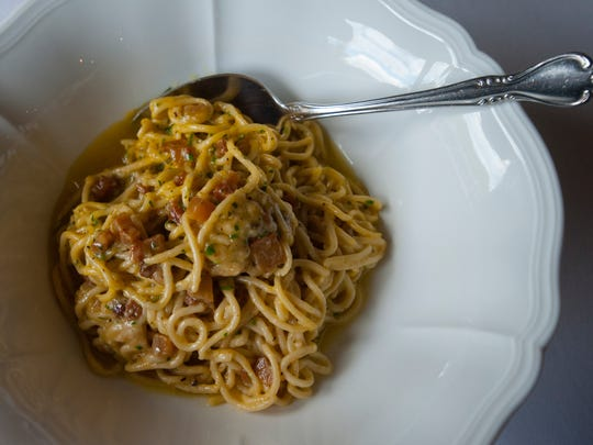 Volare Restaurant's new Carbonara in Un Vaso (Carbonara in a jar,) a house-made bucatini pasta made with Stone Cross Farm guanciale (pork jowl and cheek bacon) pecorino cheese, cracked black pepper and finished with egg yolk. The jar is shaken at table side to combine the egg yolk with the hot carbonara then served.06 September 2017