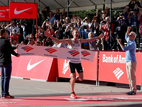 Galen Rupp of the United States wins the men's race