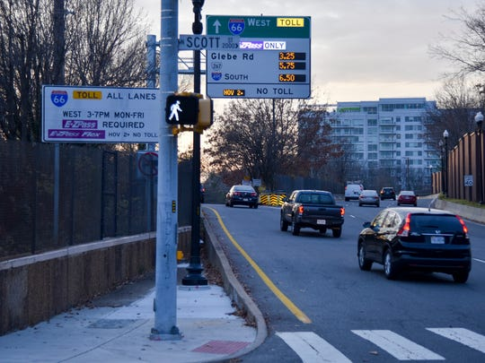 Interstate 66 toll lanes opened Monday in Washington's northern Virginia suburbs. Here cars in Arlington, Va., head toward the new lanes.