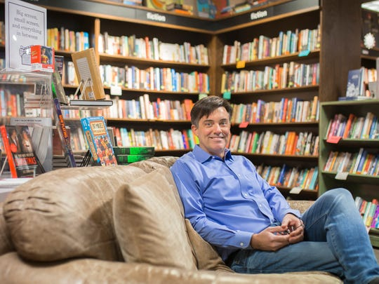 "Novelist Liam Callanan relaxes in Boswell Books, which gets a sly shoutout in his new novel ""Paris by the Book."""